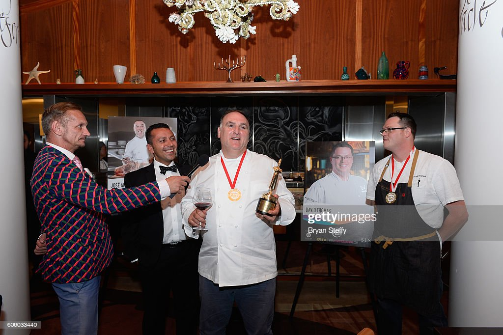 Chef Jose Andres (C) speaks after receiving the Las Vegas Food & Wine Festival Chef of the Year award as Barcelona Executive Vice President Boe Trumbull (L) and Barcelona CEO Alan Semsar (CL) and chef David Thomas (R) listen during the Las Vegas Food & Wine Festival at Bazaar Meat at SLS Las Vegas Hotel on September 15, 2016 in Las Vegas, Nevada.