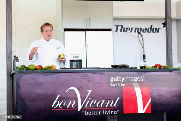 Chef Josef Felts gives a cooking demonstration during the sold out inaugural KAABOO Cayman Festival at Seven Mile Beach on February 15 2019 in Grand...