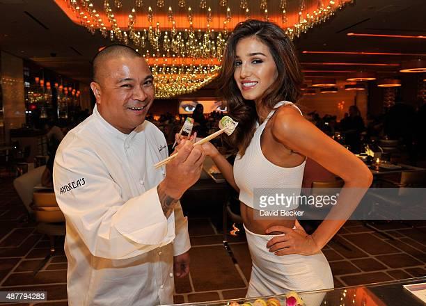Chef Joseph Elevado and model Ashley Sky appear at Andrea's at Encore Las Vegas on May 1 2014 in Las Vegas Nevada