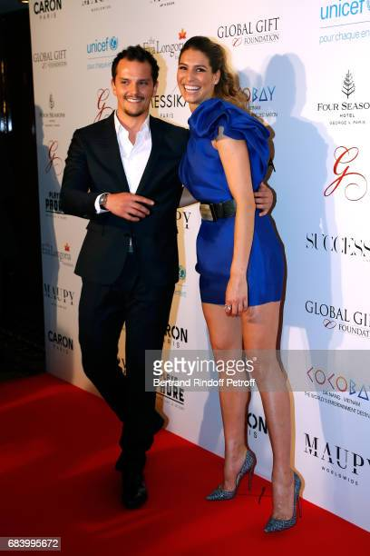Chef Juan Arbelaez and Miss france 2011 Laurie Thilleman attend the Global Gift the Eva Foundation Gala Photocall at Hotel George V on May 16 2017 in...