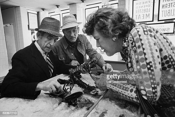 Chef Julia Child and her husband Paul picking out lobsters
