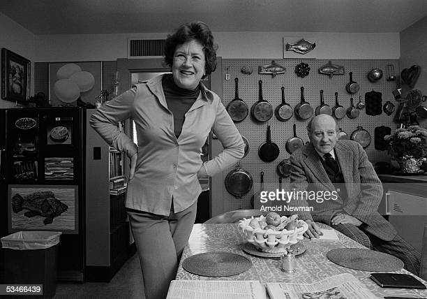 Chef Julia Child and husband Paul Child pose in the kitchen of their house La Pitchoune during a photo shoot for McCall's Magazine on June 29 1970 in...