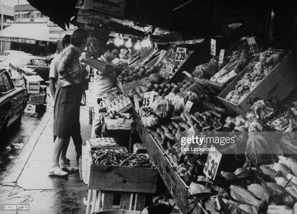 Chef Julia Child visiting vegetable market