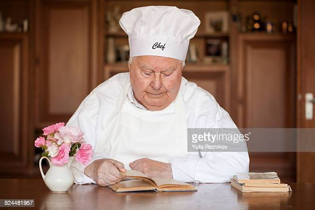 Chef looking at recipe book