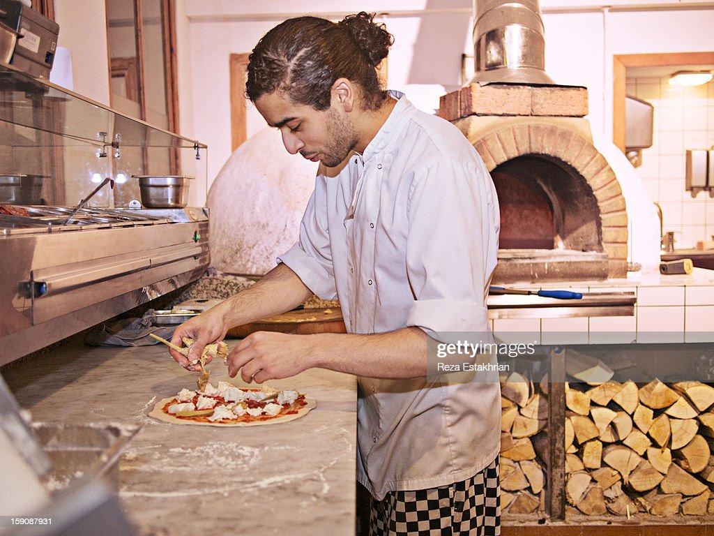 Chef makes a pizza : Stock Photo