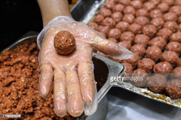 A chef makes meatballs with Impossible Burger plant based meat at the Impossible Foods Inc booth on day five of the 2nd China International Import...
