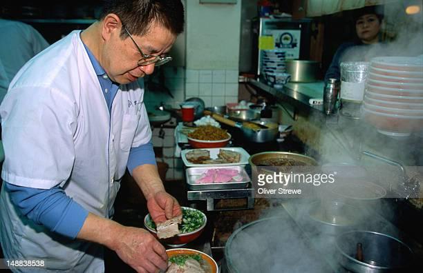 chef making chuka-siba (japanese-style ramen - wheat noodles), kyoichi ramen shop, kyoto - siba stock pictures, royalty-free photos & images