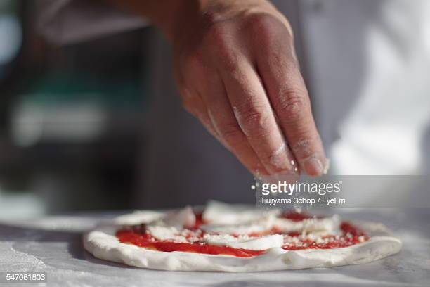 chef making pizza - making stock pictures, royalty-free photos & images
