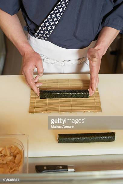 chef making sushi rolls - nori stock pictures, royalty-free photos & images