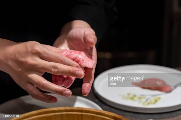 chef making wagyu sushi - nigiri stock pictures, royalty-free photos & images