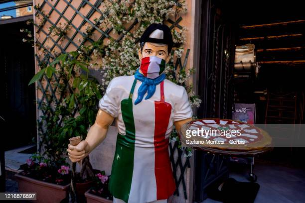 Chef mannequin of a restaurant with a tricolor mask as part of the celebration for the 74th anniversary of the proclamation of the Italian Republic,...