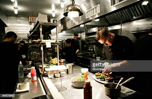 Chef Marc Forgione right works in his kitchen at Forge restaurant in the Tribeca neighborhood of New York US on Friday Aug 15 2008 Forge is located...