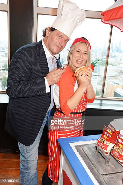 Chef Marco Pierre White poses with a finalist at the 'Walkers 'Do Us A Flavour' finalists launch at Paramount Centre Point on July 28 2014 in London...