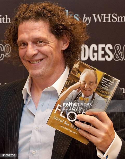 Chef Marco Pierre White signs copies of the late Keith Floyd's book 'Stirred But Not Shaken' at Selfridges on October 6 2009 in London England