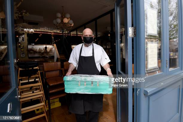 Chef Marcus Oliveira poses with food to feed to 1500 vulnerable families at Bergen House restaurant in Newington Green on April 08 2020 in London...