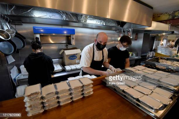 Chef Marcus Oliveira prepares food to feed to 1500 vulnerable families at Bergen House restaurant in Newington Green on April 08 2020 in London...