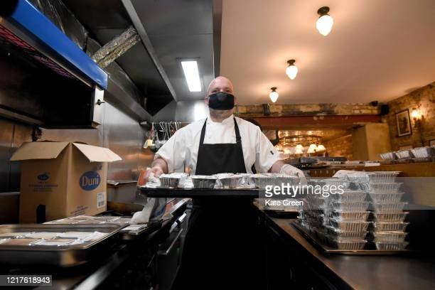 Chef Marcus Oliveira prepares food to feed to 1500 vulnerable families in Tower Hamlets at Bergen House restaurant, Newington Green on April 08, 2020...