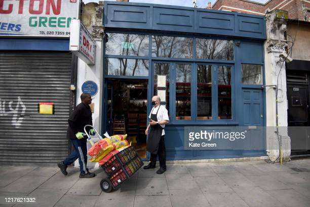 Chef Marcus Oliveira takes a delivery to prepare food to feed to 1500 vulnerable families at Bergen House restaurant in Newington Green on April 08...
