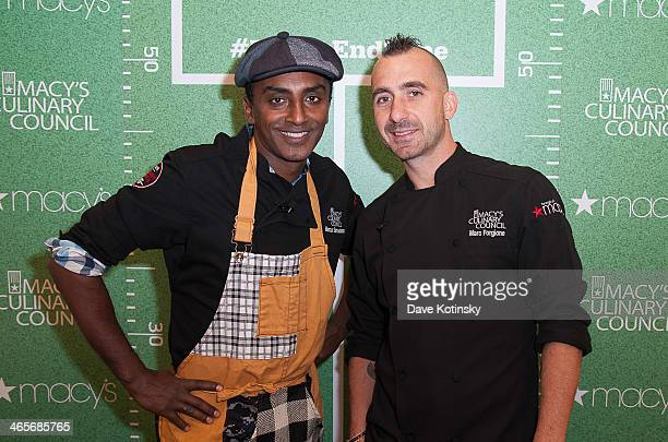 Chef Marcus Samuelsson Marc Forgione prepare select dishes at the Super Bowl XLVIII celebration at Macy's Garden State Plaza on January 28 2014 in...