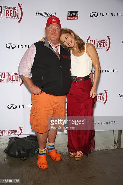 Chef Mario Batali and Deborah Dugan attend Infiniti presents the Supper to launch EAT DRINK SAVE LIVES on May 31 2015 in New York City Photo by Paul...