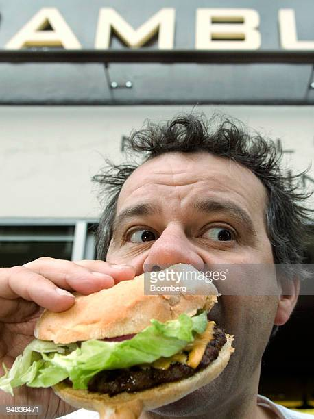Chef Mark Hix bites into a hambuger during a taste tour of burgers at London's restaurants in London UK on Monday May 12 2008 Hix is former...