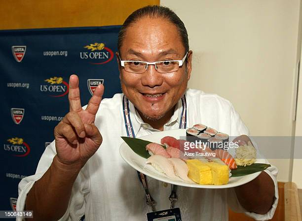 Chef Masaharu Morimoto presents a plate of sushi during a food tasting prior to the start of the 2012 US Open at the USTA Billie Jean King National...