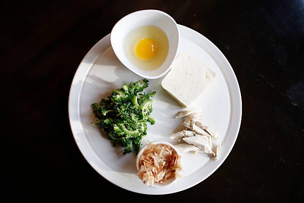 Chef Masanari Tamaki of Ramen & Izakaya Ryoji Toronto shows the ingredients for Goya Champru on January 31, 2014. For Jennifer Bain's Saucy Lady...