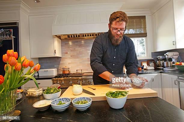 Chef Michael Cimarusti prepares dinner in the kitchen of Chef Michael Cimarusti and his wife former pastry chef Crisi Echiverri in their South...