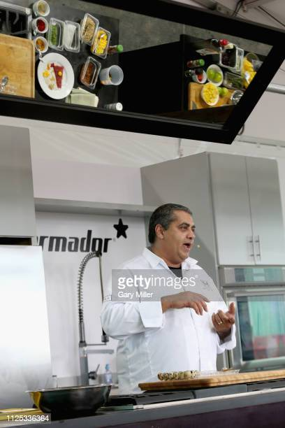 Chef Michael Mina gives a cooking demonstration during the sold out inaugural KAABOO Cayman Festival at Seven Mile Beach on February 15 2019 in Grand...