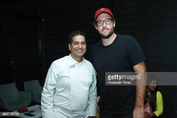 Chef Michael Swamy with cricketer Daniel Vettori during special dinner for Royal Challengers Bangalore teammates by Virat Kohli at his new restaurant...