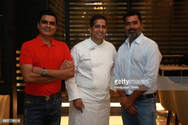 Chef Michael Swamy with Sharad and Vikrant Batra during special dinner for Royal Challengers Bangalore teammates by Virat Kohli at his new restaurant...