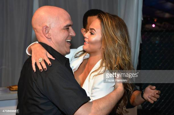 Chef Michael Symon and Christine Teigen attend Sports Illustrated Swimsuit at Moet Hennessy's The Q at Miami Beach on February 20 2014 in Miami...