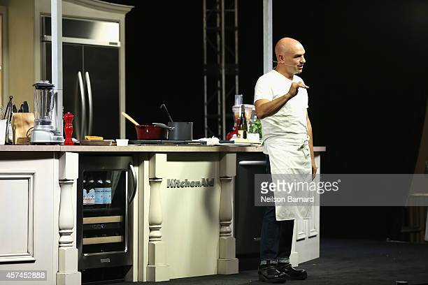 Chef Michael Symon conducts a culinary presentation at KitchenAid stage at the Grand Tasting presented by ShopRite featuring KitchenAid® culinary...