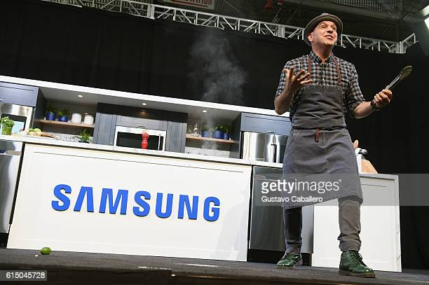 Chef Michael Symon on stage during the Grand Tasting presented by ShopRite featuring Samsung culinary demonstrations presented by MasterCard at the...