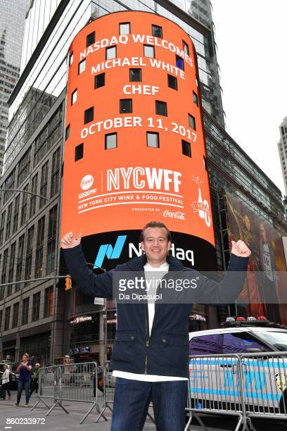 Chef Michael White poses after ringing the opening bell with the Food Network Cooking Channel New York City Wine Food Festival presented by CocaCola...