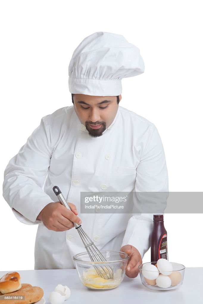 Chef mixing egg in bowl : Stock Photo