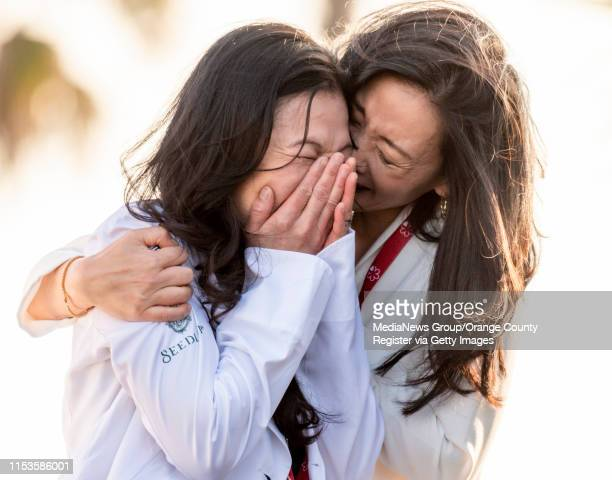 Chef Niki Nakayama left is overcome with emotion as she is embraced by her wife Carole Iida after her restuarant n/naka in Los Angeles was awarded...