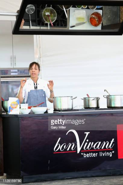 Chef Nina Compton gives a cooking demonstration during the sold out inaugural KAABOO Cayman Festival at Seven Mile Beach on February 15 2019 in Grand...