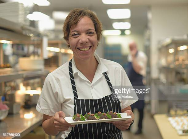 Chef Nina Compton prepares food for a Dinner Hosted By Scott Conant Michael Pirolo And Nina Compton during 2016 Food Network Cooking Channel South...