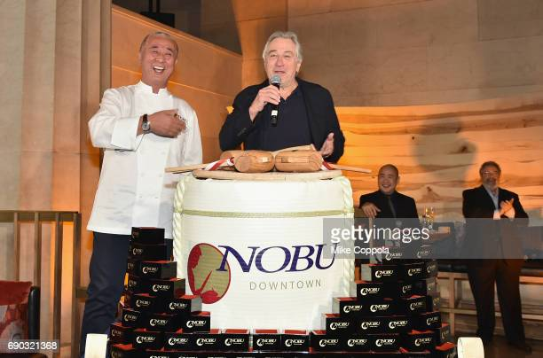 Chef Nobu Matsuhisa and Robert De Niro speak onstage during the Nobu Downtown Sake Ceremony at Nobu Downtown on May 30 2017 in New York City