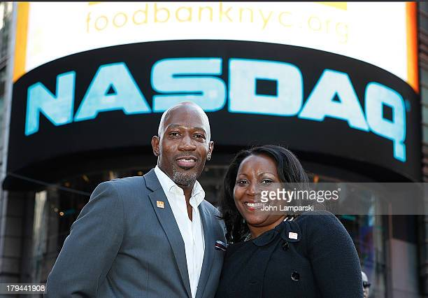 Chef of Food Bank Madison Bowan President and CEO of Food Bank Margaret Purvis ring the closing bell at NASDAQ on September 3 2013 in New York City
