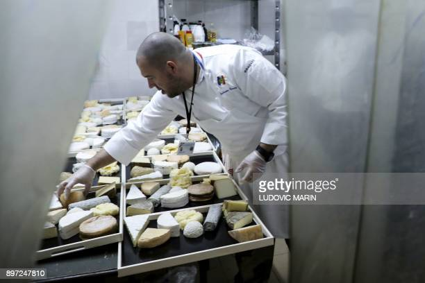 Chef of the Elysee presidential Palace Guillaume Gomez prepares cheese for a Christmas dinner with the French president and French troops...