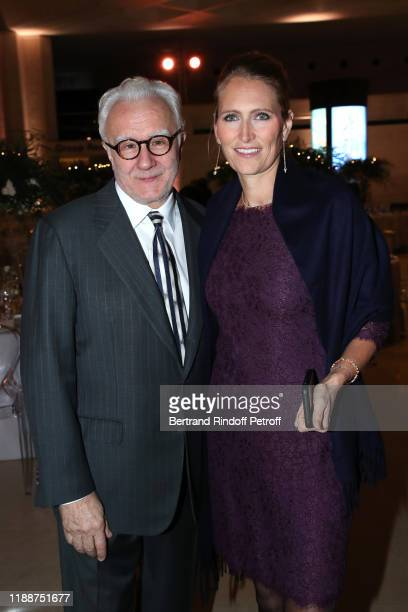 Chef of the event Alain Ducasse and his wife Gwenaelle Gueguen attend the Grand Dinner of the Louvre on November 19 2019 in Paris France