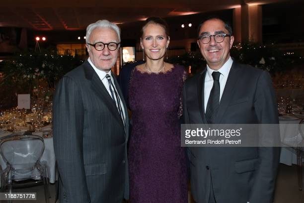 Chef of the event Alain Ducasse his wife Gwenaelle Gueguen and President and Director of the Public Establishment of the Louvre Museum JeanLuc...
