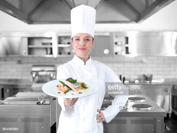Chef offering fish plate