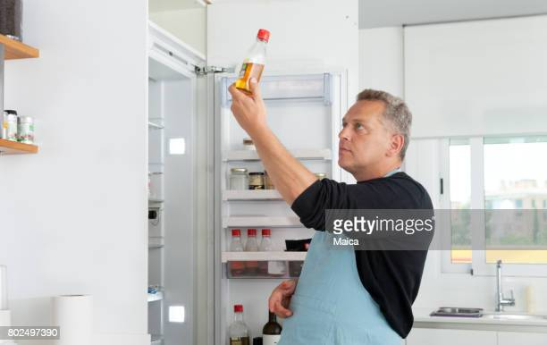 Chef opening refrigerator door