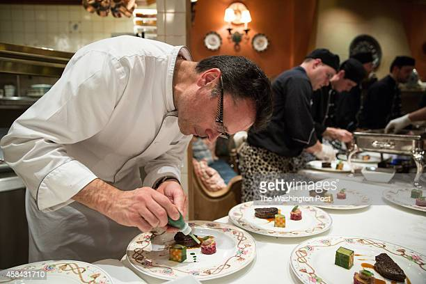Chef Patrick Bertron of Relais Bernard Loiseau prepares a beef course for a gala dinner at the The Inn at Little Washington celebrating the 60th...