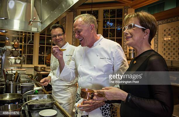 Chef Patrick O'Connell tastes a sauce in the kitchen at the Inn at Little Washington with Chef Patrick Bertron of Relais Bernard Loiseau and...