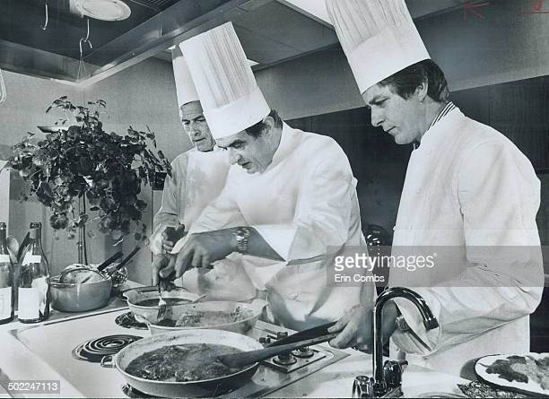 Chef Paul Bocuse centre swiftly works his culinary magie in The Star test kitcher day as Chef Marcel Didier of the Royal Y and Chef Francis...