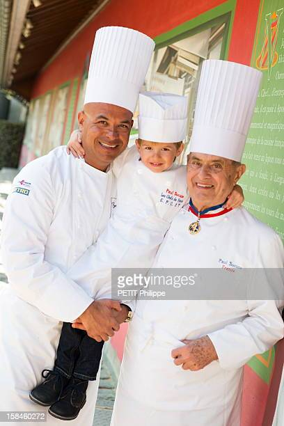 MONTd'OR FRANCE MARCH 28 Chef Paul Bocuse with his son Jerome and grandson Paul JR in the restaurant of Chef Paul Bocuse CollongeauMontd'Or near Lyon...